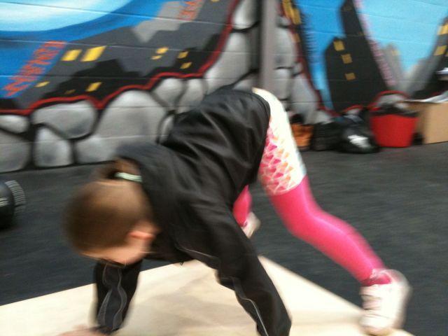 Jadzia doing Crossfit Kids' Bear crawl