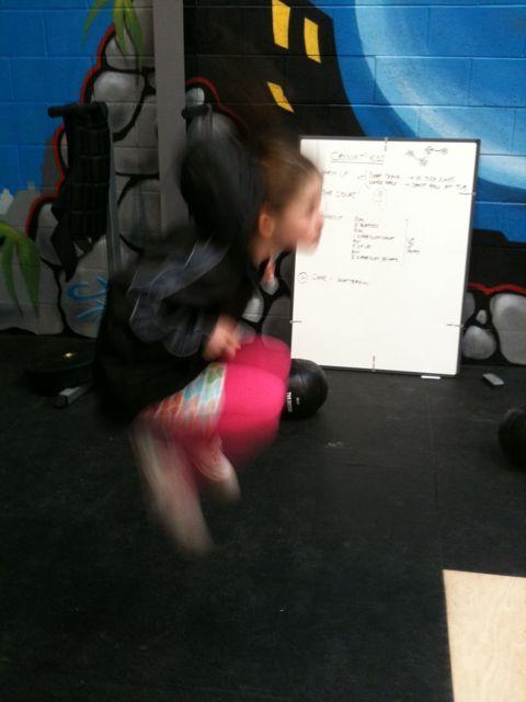Jadzia doing Crossfit Kids' tuck jumps