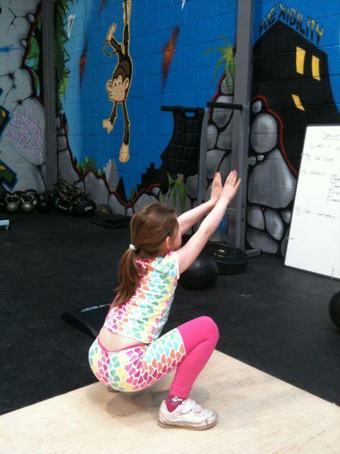 Jadzia doing Crossfit Kids' squats