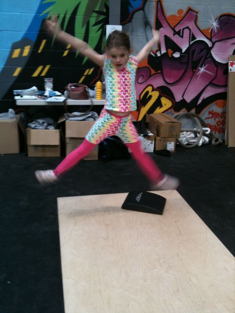 Jadzia doing Crossfit Kids' burpees - throwing shapes in the jump