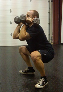 DB Hang Squat Clean in the squat position